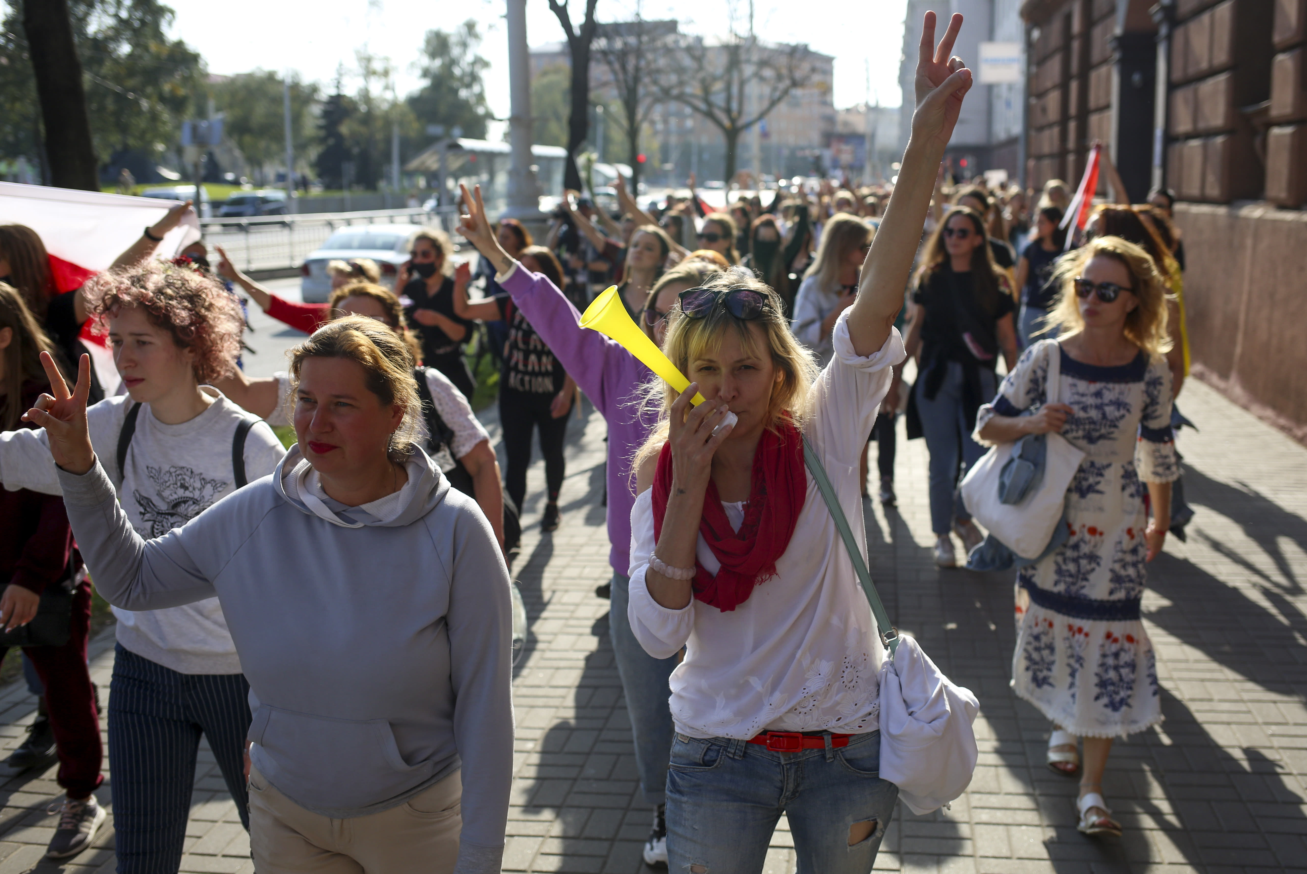 Belarusian women attend an opposition rally to protest the official presidential election results in Minsk, Belarus, Saturday, Sept. 26, 2020. Hundreds of thousands of Belarusians have been protesting daily since the Aug. 9 presidential election. (AP Photo/TUT.by)