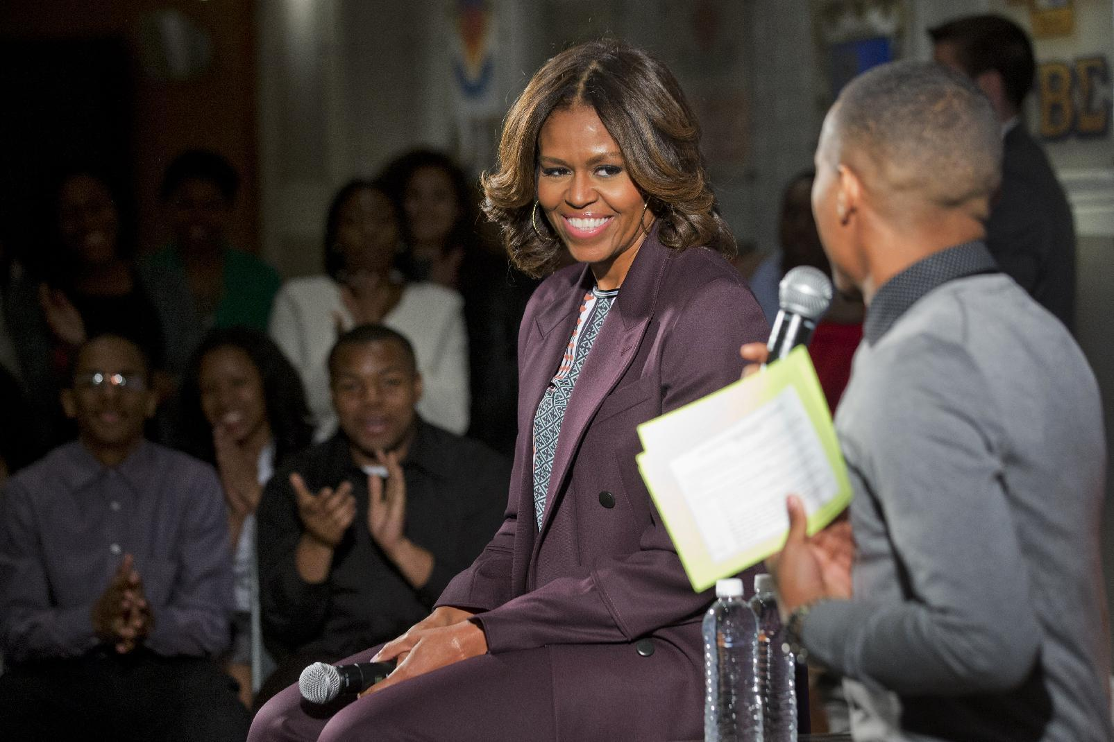First lady Michelle Obama smiles at rapper Bow Wow at Howard University in Washington, Thursday April 17, 2014. The first lady joined juniors and seniors from Chicago public high schools on the first day of their four-day visit to Howard University, as part of a program to immerse talented high school students in a college campus environment. (AP Photo/Jacquelyn Martin)