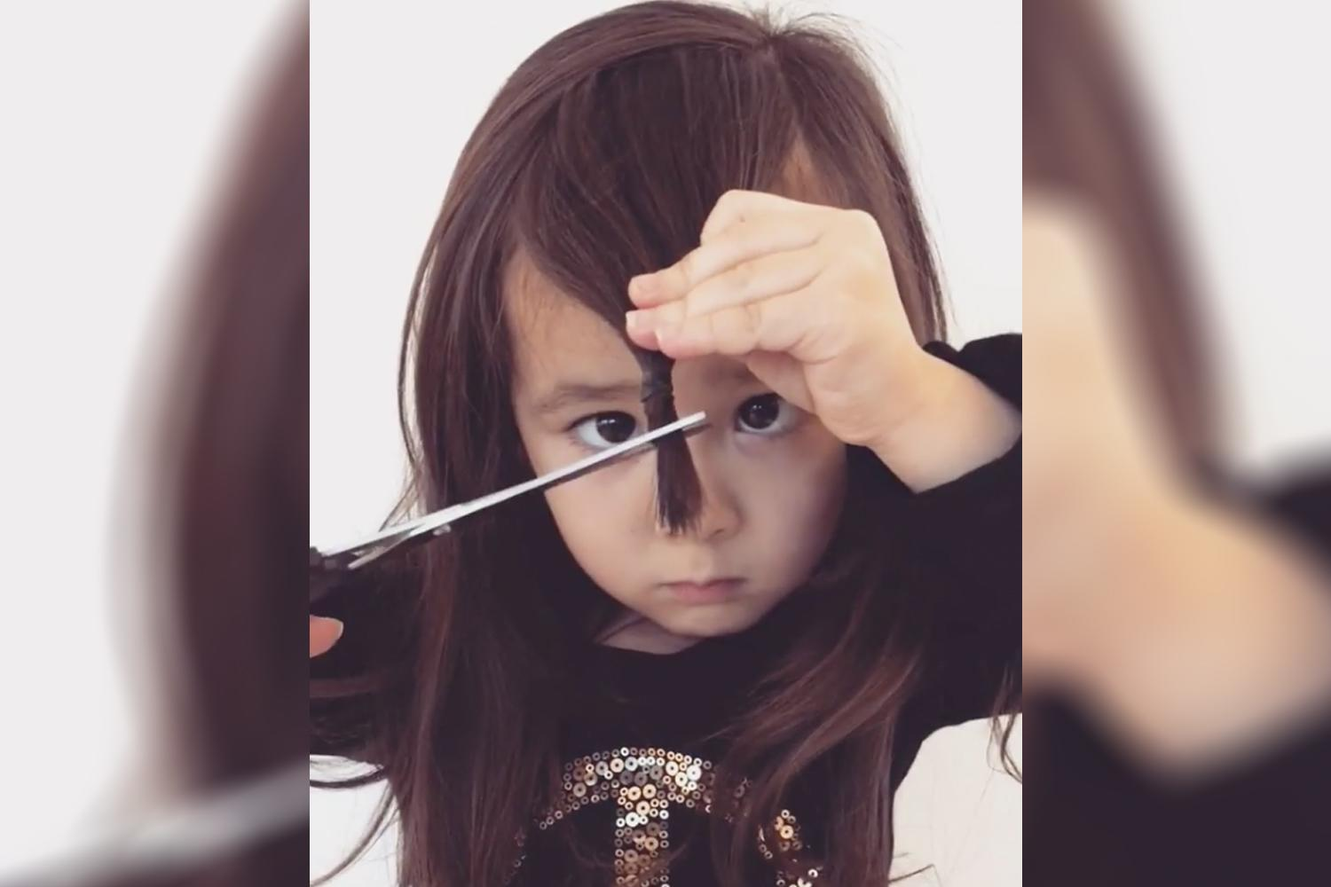 This video of a 4 year old girl cutting her own bangs will make you cringe