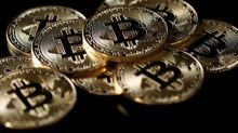 Virtual currency meets finance in glitzy Swiss resort