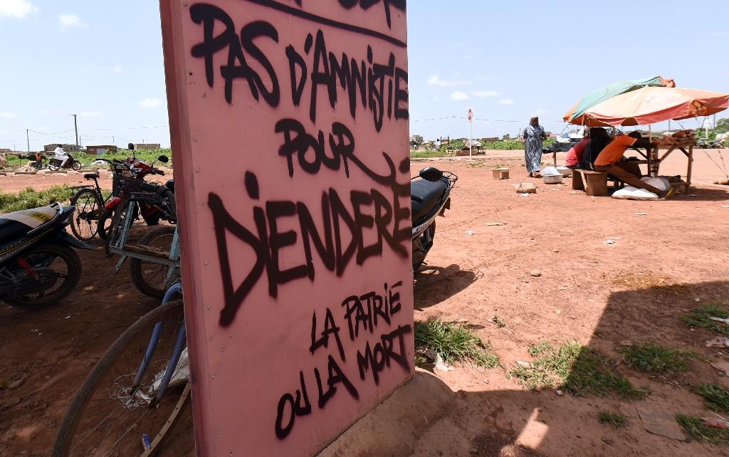 """A sign reading """"No amnesty for Diendere, the motherland of death"""" is seen in Ouagadougou, Burkina Faso on October 1, 2015 (AFP Photo/Sia Kambou)"""