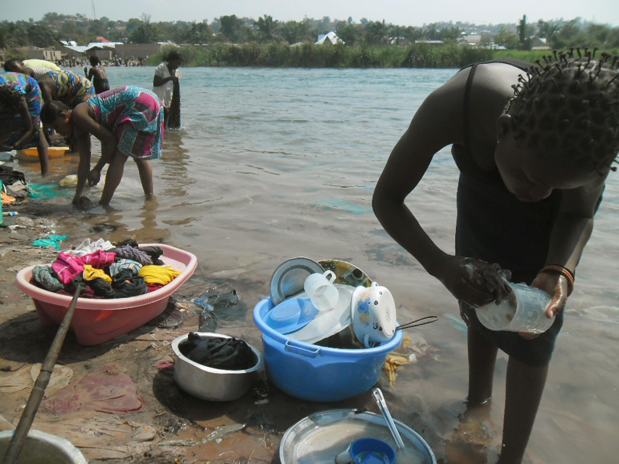 Women in Kalemie in DR Congo's Katanga province wash clothes on September 9, 2014 in the Lukaga river that runs into Lake Tanganyika (AFP Photo/Lucien Kahozi)