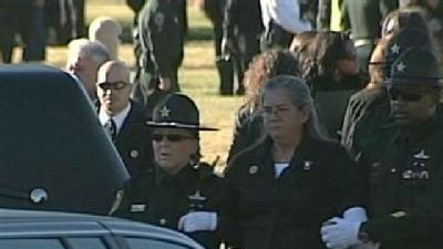 Graveside Service Held For Coates