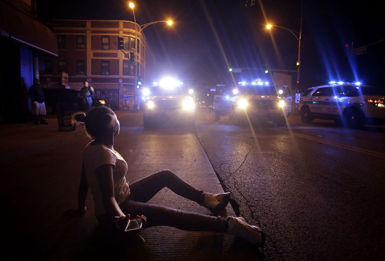 <p>Protesters demonstrate against recent police shooting in Chicago</p><p>A demonstrator protesting the fatal police shooting of Paul O'Neal lays in the street in front of a police vehicle on August 5, 2016 in Chicago, Illinois. (Photo: Joshua Lott/Getty Images)</p>