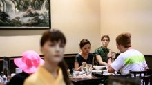 'Model' customers keep Tokyo diners at social distance