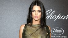 Kendall Jenner goes braless in a sheer mini dress at Cannes