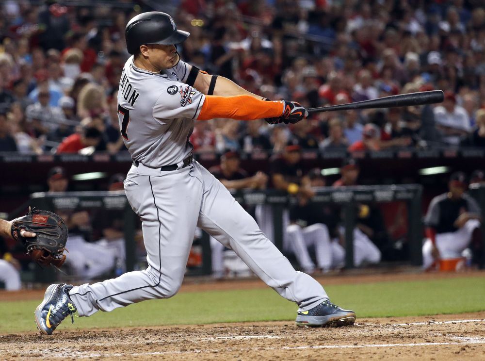 Marlins' slugger Giancarlo Stanton launches his 57th homer of the season. (AP)