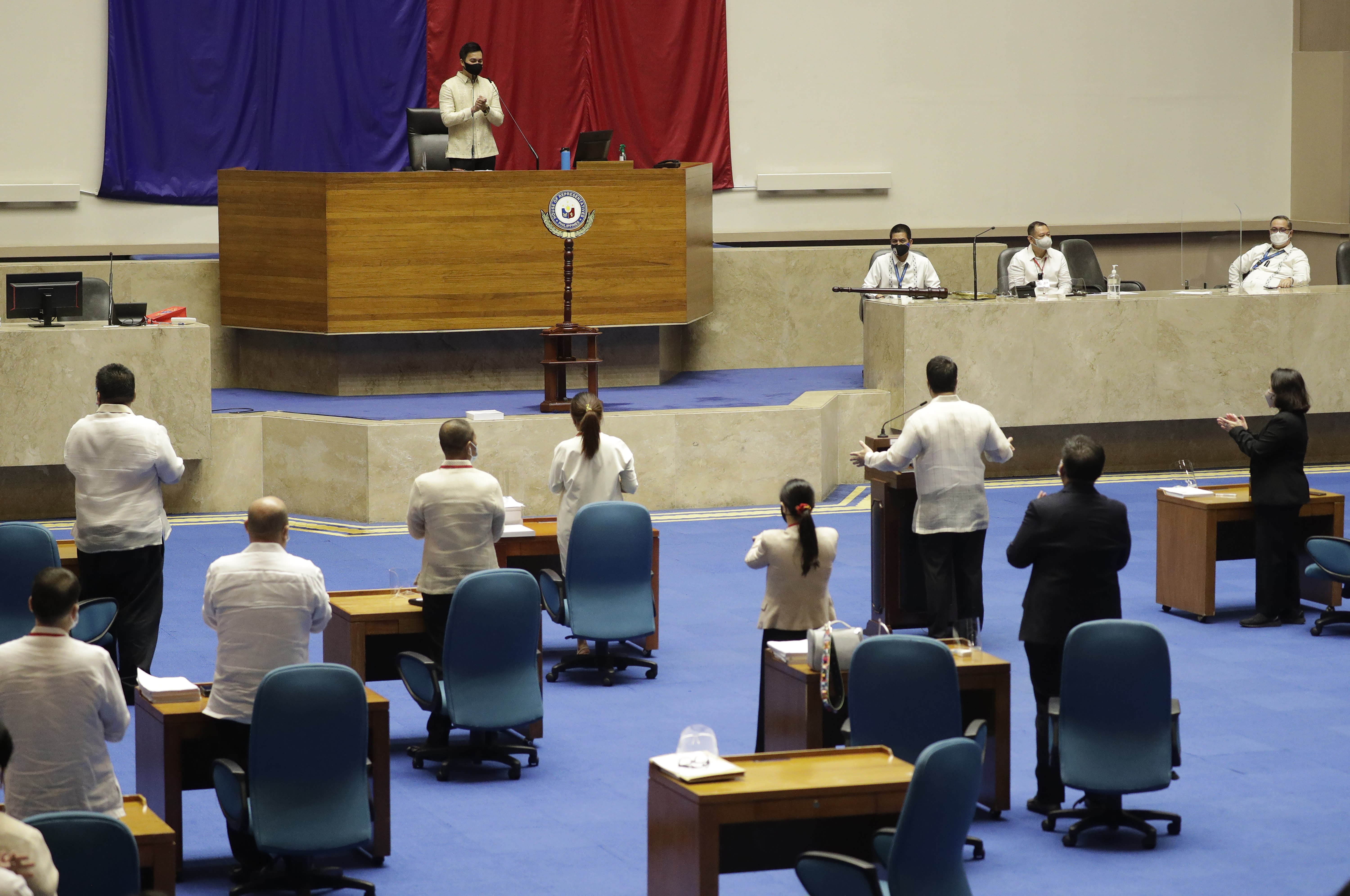 New House Speaker Lord Allan Velasco gestures during his first day at the House of Representatives in Quezon city, Philippines on Tuesday, Oct. 13, 2020. A large faction of Philippine legislators in the House of Representatives elected a new leader Monday in a tense political standoff between two allies of the president. (AP Photo/Aaron Favila)