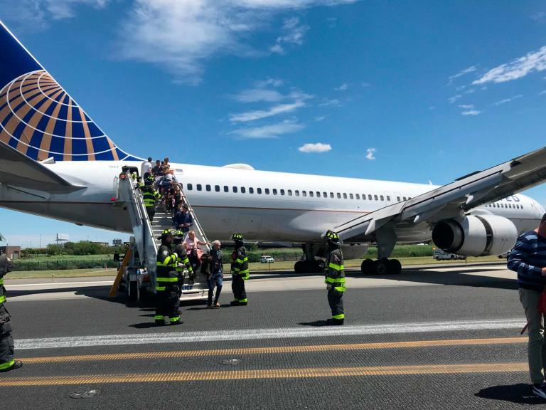 """A United Airlines plane skidded off the runway after its tyres burst as it landed at an airport near New York.Some passengers suffered minor injuries when Flight 627 slid off the tarmac at Newark Liberty International Airport in New Jersey on Saturday afternoon.The Federal Aviation Administration (FAA) said the Boeing 757-200's left main landing gear was """"stuck in a grassy area"""" following the incident at 1pm.""""The aircraft will be towed off the airfield after passengers leave the aircraft via stairs,"""" it added in a statement.No injuries were reported to the FAA but United said some passengers had refused treatment for minor injuries. The airline did not say how many people were hurt.The pilot told those on board the plane had blown two tyres as it landed, according to passenger Caroline Craddock. She said at least one person hit their head and another suffered an elbow injury.Arrivals and departures were suspended at Newark following the incident. Flights resumed after passengers were """"safely deplaned"""", the airport tweeted.The FAA said it was sending officials to the airport to begin an investigation."""