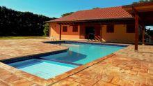 Piscina e ambientes espaçosos: esta casa de campo em Maringá é um sonho