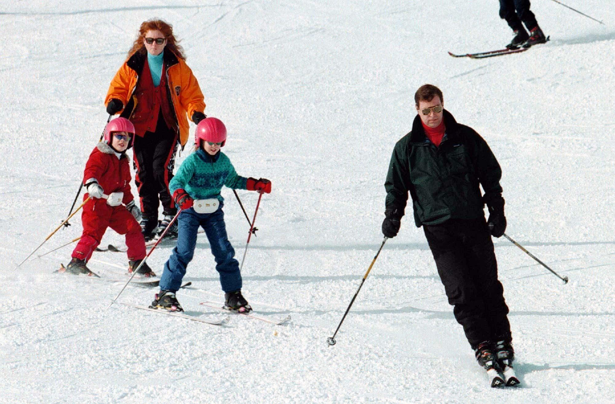 The Duke and Duchess of York with their daughter's Beatrice (right) and Eugenie on the Swiss ski slopes above, the ski resort of Verbier. Photo by John Stillwell/PA.