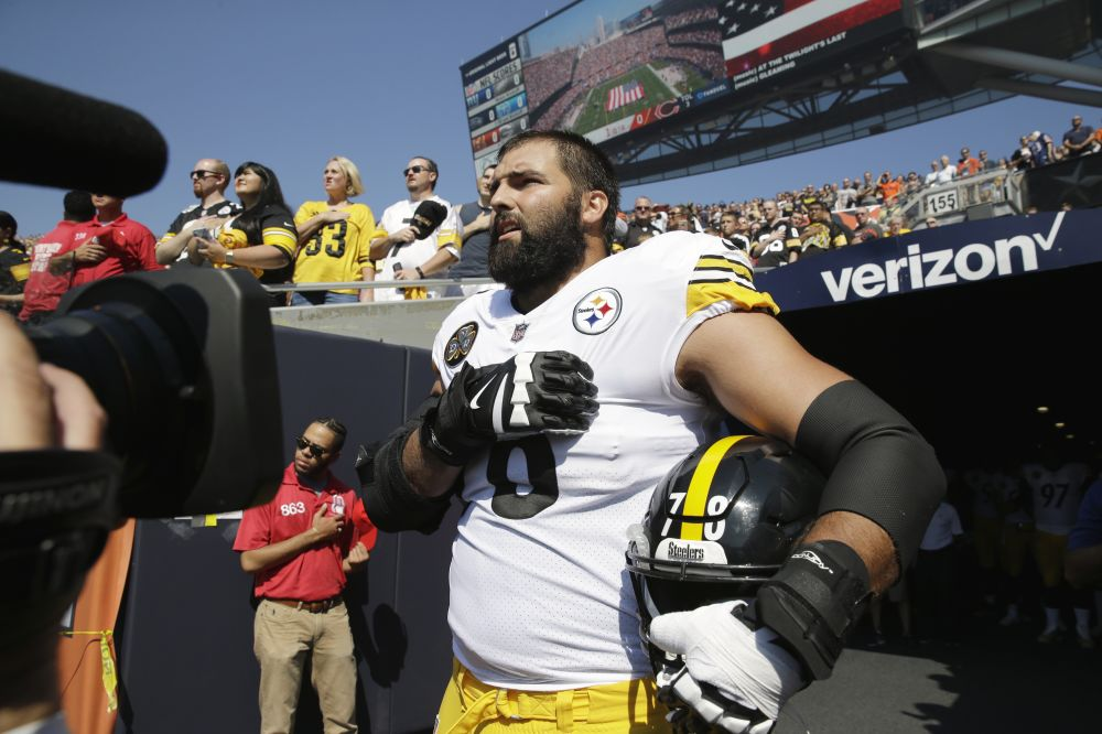 Steelers offensive tackle and former Army Ranger Alejandro Villanueva (78) stands outside the tunnel alone during the national anthem. (AP)