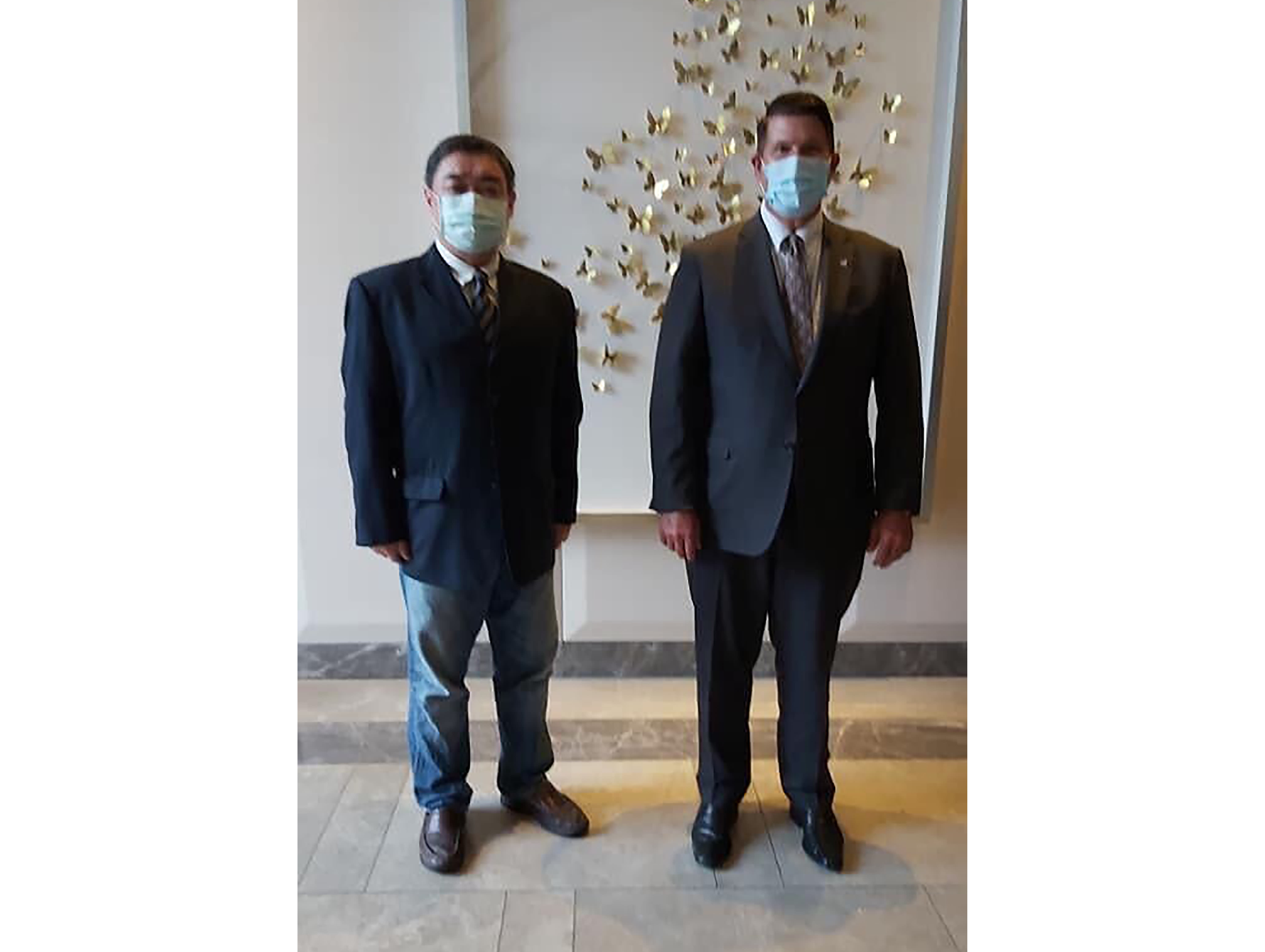 In this photo released by Wu'er Kai Xi, one of the top dissidents from China's Tiananmen Square massacre Wu'er Kai Xi, left, poses with visiting U.S. Under Secretary of State Keith Krach in Taipei, Taiwan, Friday, Sept. 18, 2020. Krach, the second high-level U.S. envoy to visit Taiwan in two months began a day of closed-door meetings Friday as China conducted military drills near the Taiwan Strait after threatening retaliation. (Wu'er Kai Xi via AP)