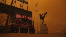Giants, Athletics play under ominous orange sky amid California wildfires