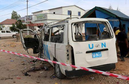 A U.N. van is seen damaged by an improvised explosive device outside the U.N. compound in Garowe