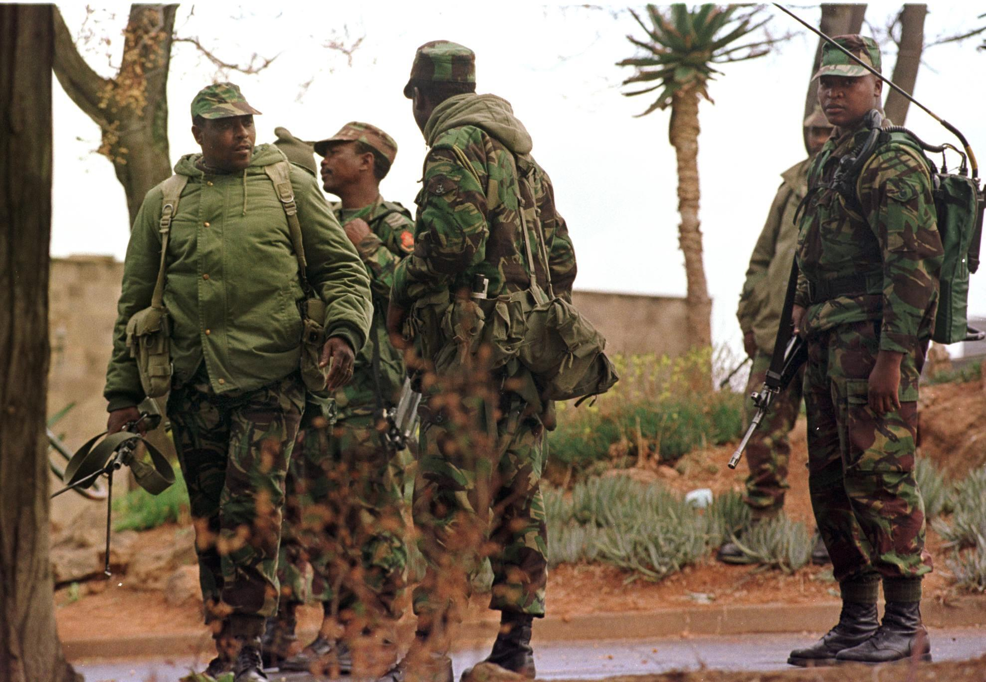 File photo shows members of the Lesotho military on patrol in the capital Maseru, on September 17, 1999