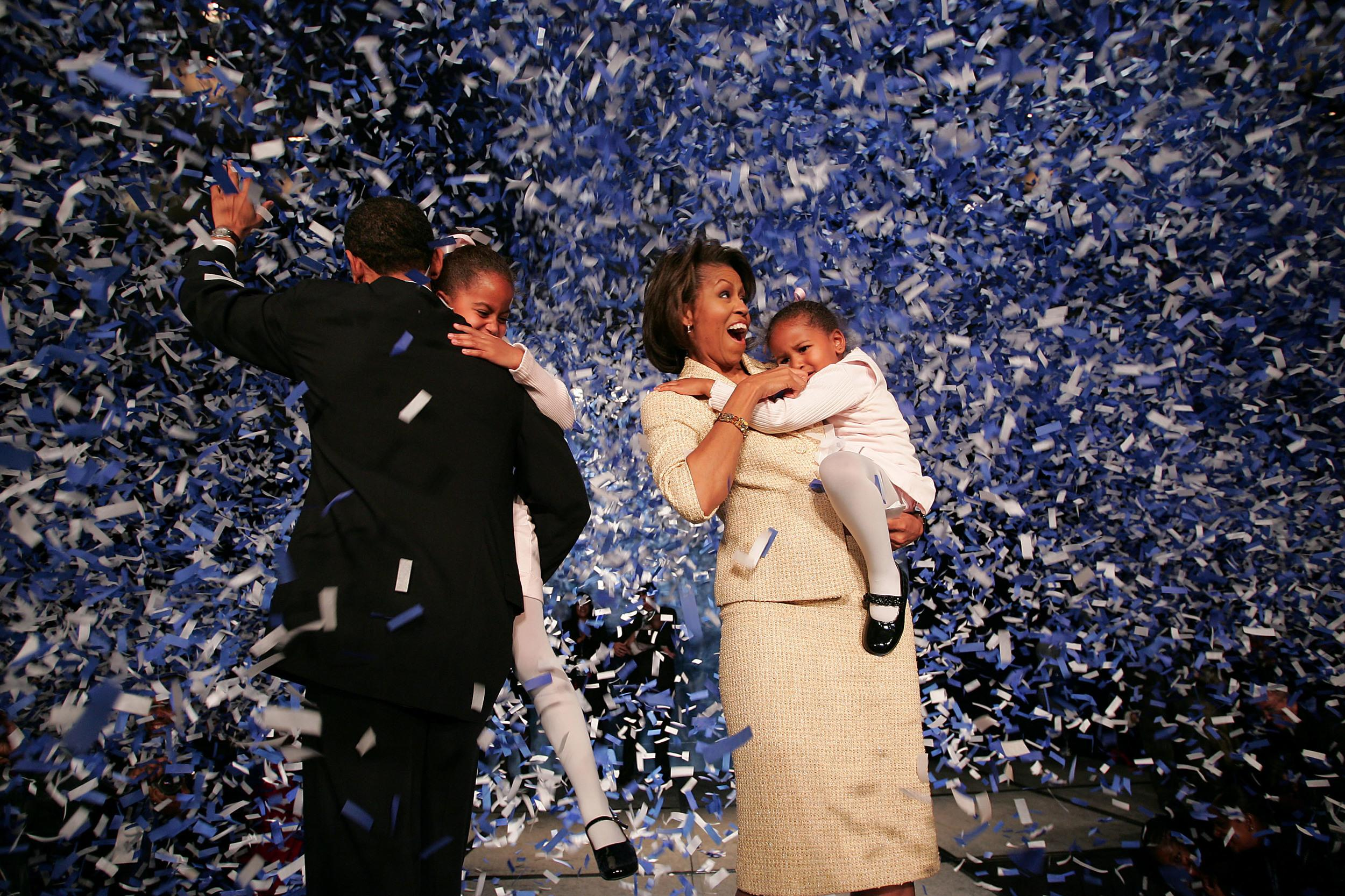 <p>Candidate for the U.S. Senate Barack Obama (D-IL) (L) holding his daughter Malia with wife Michelle and youngest daughter Sasha (R) celebrate his victory with supporters over Repulican rival Alan Keyes November 2, 2004 in Chicago, Illinois. Obama was expected to easily defeat Keyes in this first ever senate race featuring two major-party African-American candidates.</p>  <p>(Photo by Scott Olson/Getty Images)</p>