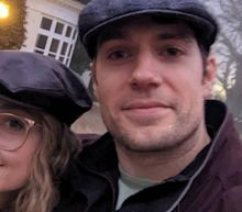 Henry Cavill slams critics of his relationship, says he's 'very happy in love'