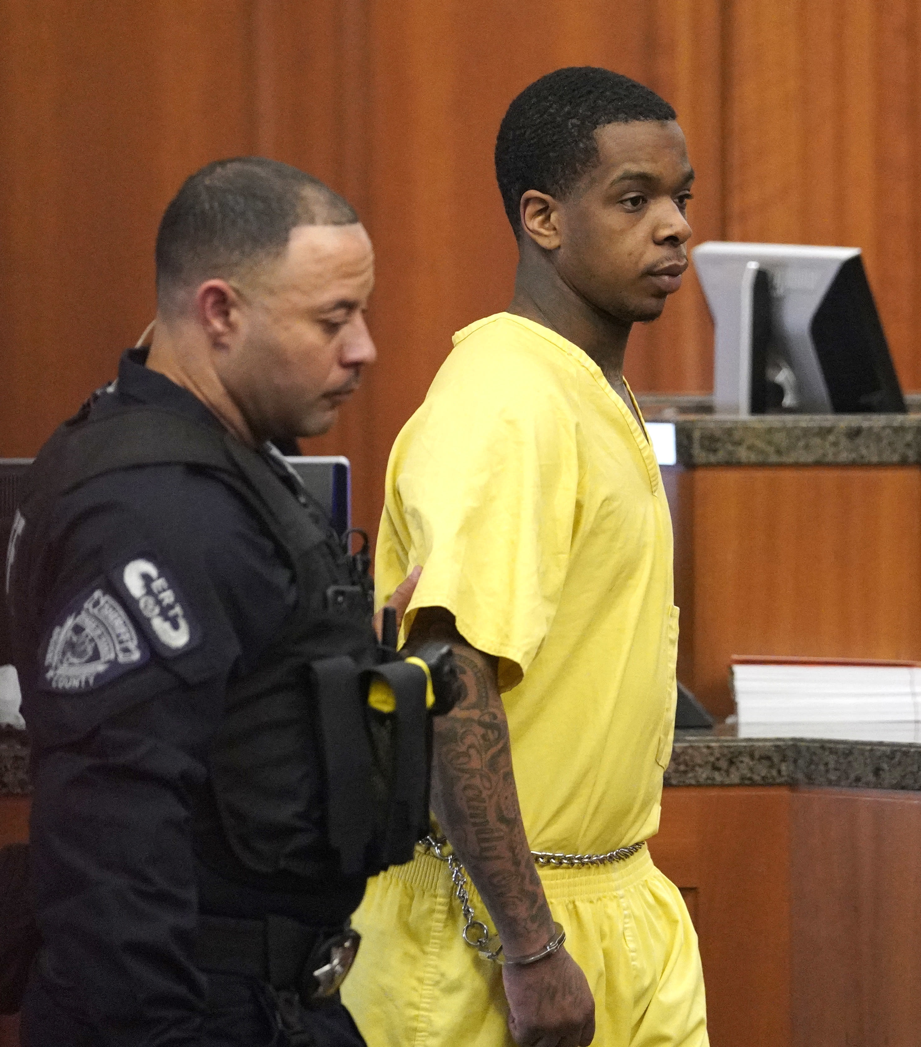 Larry D. Woodruffe, right, is escorted from the courtroom after a hearing Thursday, Jan. 10, 2019, in Houston. Woodruffe is charged with capital murder in the Dec. 30, 2018 slaying of 7-year-old Jazmine Barnes. (AP Photo/David J. Phillip)