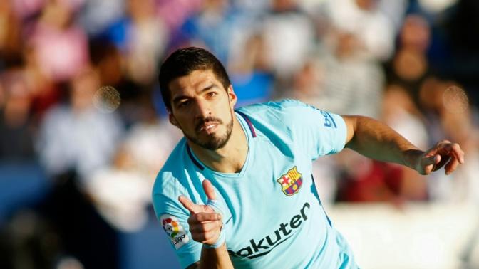 Suarez doubles stretches Barcelona's La Liga lead
