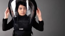This air purifying face-shield creates a bubble of safety around its wearer