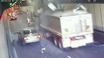 Watch: Truck tears up roof of tunnel