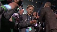 The Selfie Kid explains why he was glued to his phone during Justin Timberlake's halftime performance
