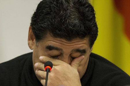 Former Argentine soccer player Maradona attends a news conference in Rome