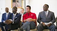 Papa John's, college president spar over scholarship funding
