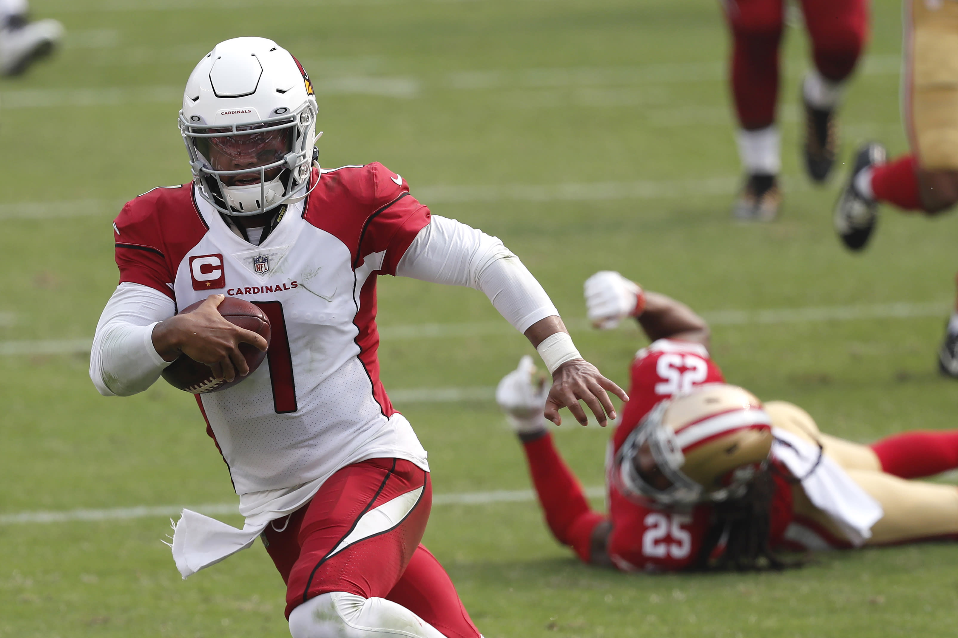 Arizona Cardinals quarterback Kyler Murray (1) runs past San Francisco 49ers cornerback Richard Sherman (25) to score a touchdown during the second half of an NFL football game in Santa Clara, Calif., Sunday, Sept. 13, 2020. (AP Photo/Josie Lepe)