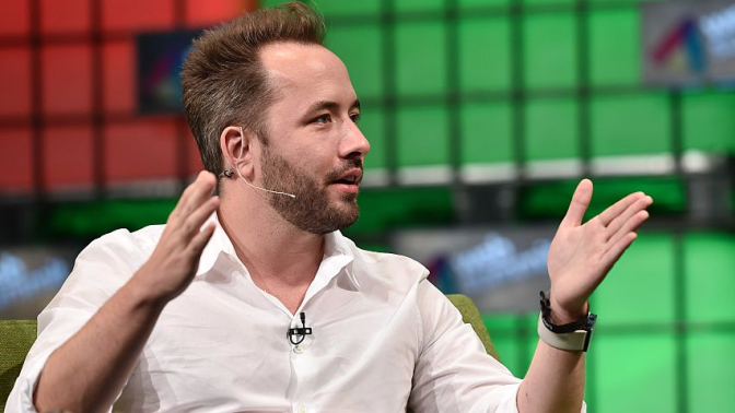 Dropbox opens at $29, surging 38% in debut