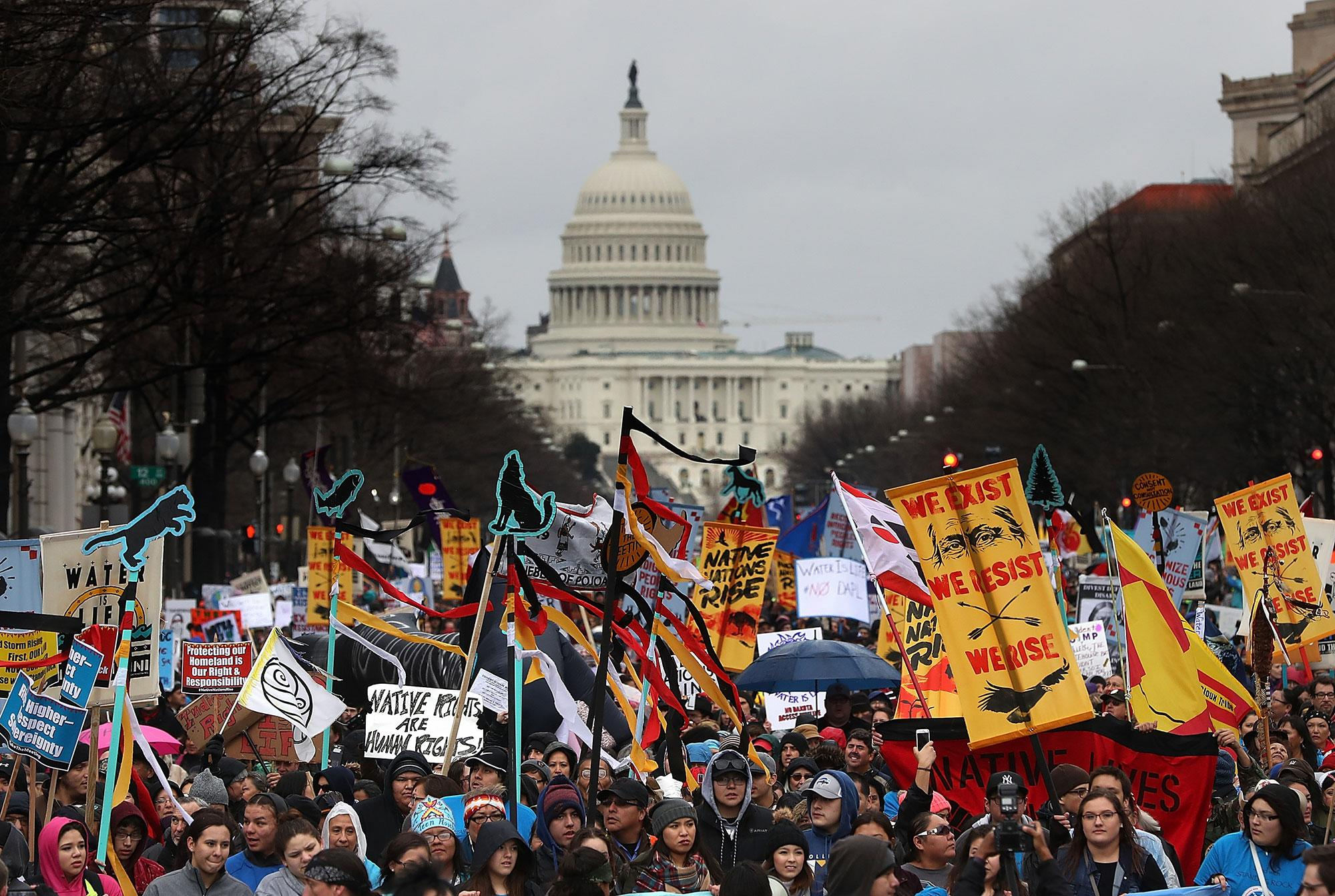 <p>Protesters march during a demonstration against the Dakota Access Pipeline on March 10, 2017 in Washington, DC. Thousands of protesters and members of Native nations marched in Washington DC to oppose the construction of the proposed 1,172 Dakota Access Pipeline that runs within a half-mile of the Standing Rock Sioux reservation in North Dakota. (Justin Sullivan/Getty Images) </p>