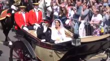 Harry and Meghan ride past in horse-drawn carriage