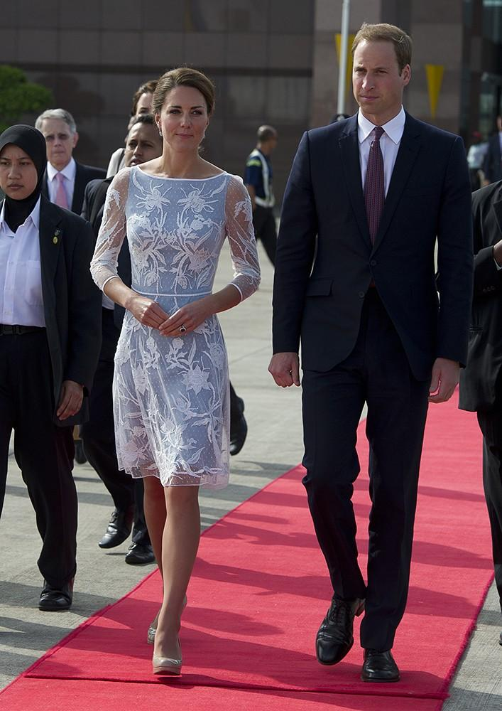 While in Malaysia, Kate wore an ice blue lace Temperley London dress, with her hair pulled back in a pretty updo.