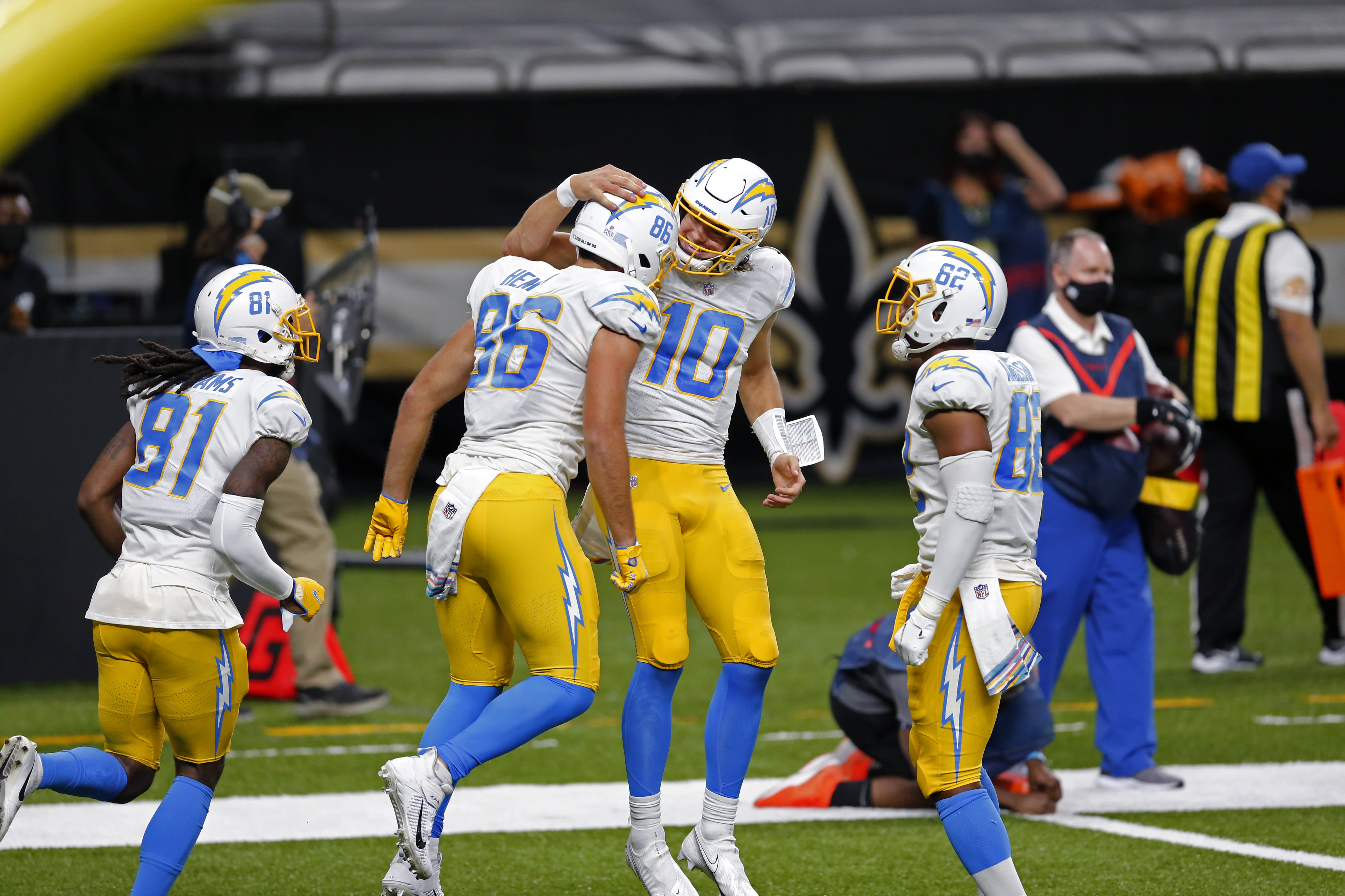 Los Angeles Chargers quarterback Justin Herbert (10) and tight end Hunter Henry (86) celebrate their touchdown pass in the first half of an NFL football game against the New Orleans Saints in New Orleans, Monday, Oct. 12, 2020. (AP Photo/Brett Duke)