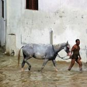 Eastern India struggles to evacuate reluctant villagers as floods wreak havoc