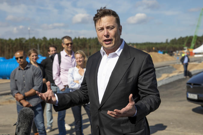 FUERSTENWALDE, GERMANY - SEPTEMBER 03: Tesla head Elon Musk talks to the press as he arrives to have a look at the construction site of the new Tesla Gigafactory near Berlin on September 03, 2020 near Gruenheide, Germany. Musk is currently in Germany where he met with vaccine maker CureVac on Tuesday, with which Tesla has a cooperation to build devices for producing RNA vaccines, as well as German Economy Minister Peter Altmaier yesterday. (Photo by Maja Hitij/Getty Images)