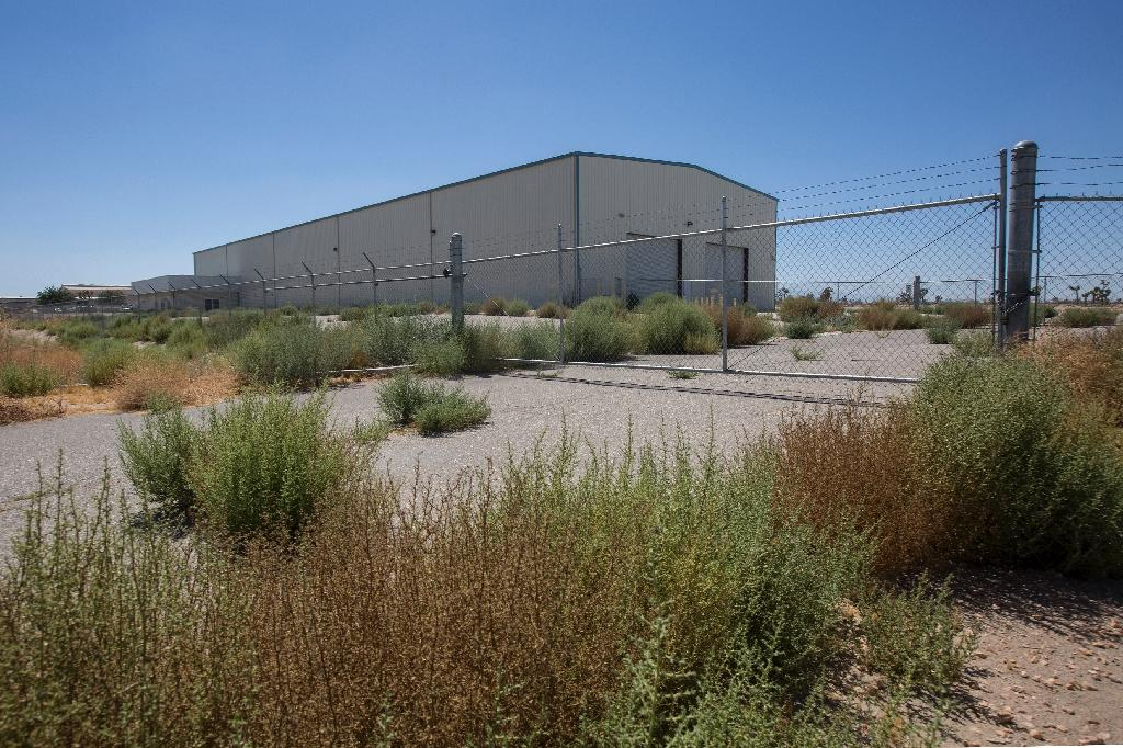 """The decision by Adelanto city officials to allow marijuana cultivation led to a flood of high-end investors rushing to buy up warehouses and plots of land in """"green zones"""" earmarked for cultivation (AFP Photo/David McNew)"""