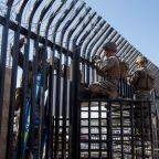U.S. lays barbed wire at border as migrant caravan draws closer