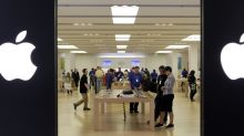 Apple lifts the Dow; GM in court; Macy's spikes on Starboard's urging