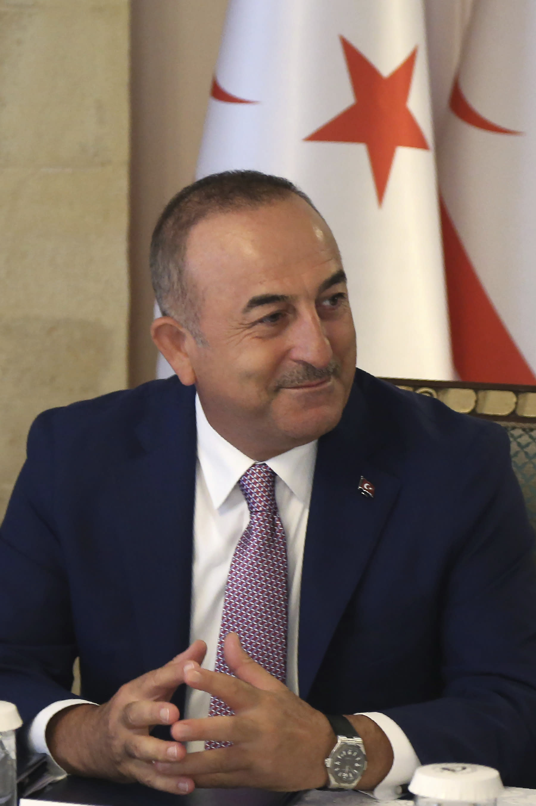 Turkish Foreign Minister Mevlut Cavusoglu talks during a meeting with Turkish Cypriot leader Mustafa Akinci in the Turkish occupied area in the northern part of divided capital Nicosia, Cyprus, Monday, Sept. 9, 2019. Cavusoglu is in the northern part of divided Cyprus for three-day visit. (AP Photo/Petros Karadjias)