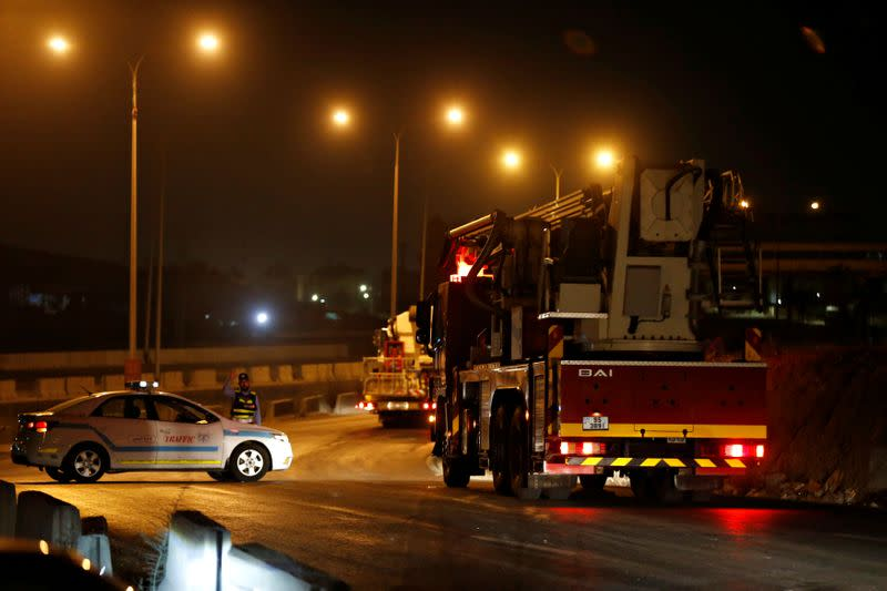 Civil defense vehicles leave for Amman at the highway between Amman and the city of Zarqa