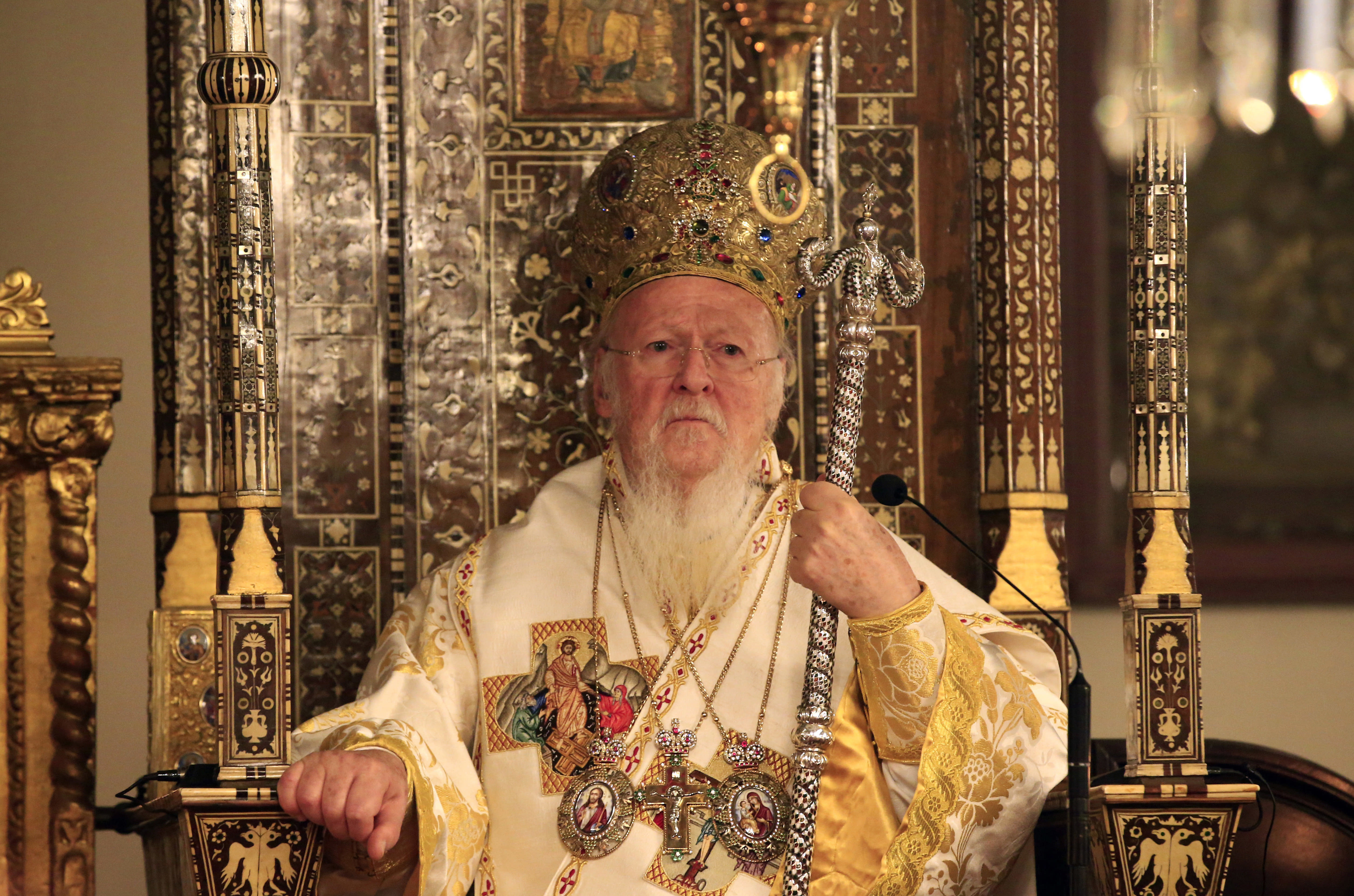 FILE - In this early Sunday, April 16, 2017 file photo, Ecumenical Patriarch Bartholomew I, the spiritual leader of the world's Orthodox Christians, leads the Easter Resurrection Service at the Patriarchal Cathedral of St. George in Istanbul, Turkey. The Russian hackers indicted by the U.S. special prosecutor in July 2018 have spent years trying to steal the private correspondence of some of the world's most senior Christian Orthodox figures, including top aides to Bartholomew, The Associated Press has found, illustrating the high stakes as Kiev and Moscow wrestle over the religious future of Ukraine. (AP Photo/Lefteris Pitarakis, File)