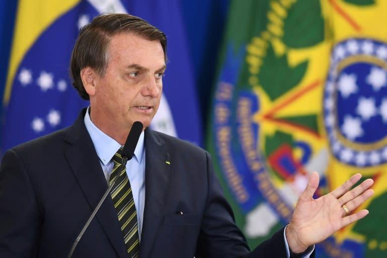 Brazilian President Jair Bolsonaro, pictured giving a speech in Brasilia on December 9, 2019, says God is Brazilian