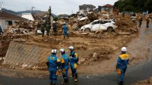 Japanese PM visits flood disaster zone, new warnings issued