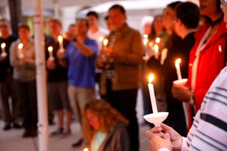 A candlelight vigil is held at Rancho Bernardo Community Presbyterian Church for victims of a shooting incident at the Congregation Chabad synagogue in Poway, north of San Diego, California, U.S. April 27, 2019. REUTERS/John Gastaldo