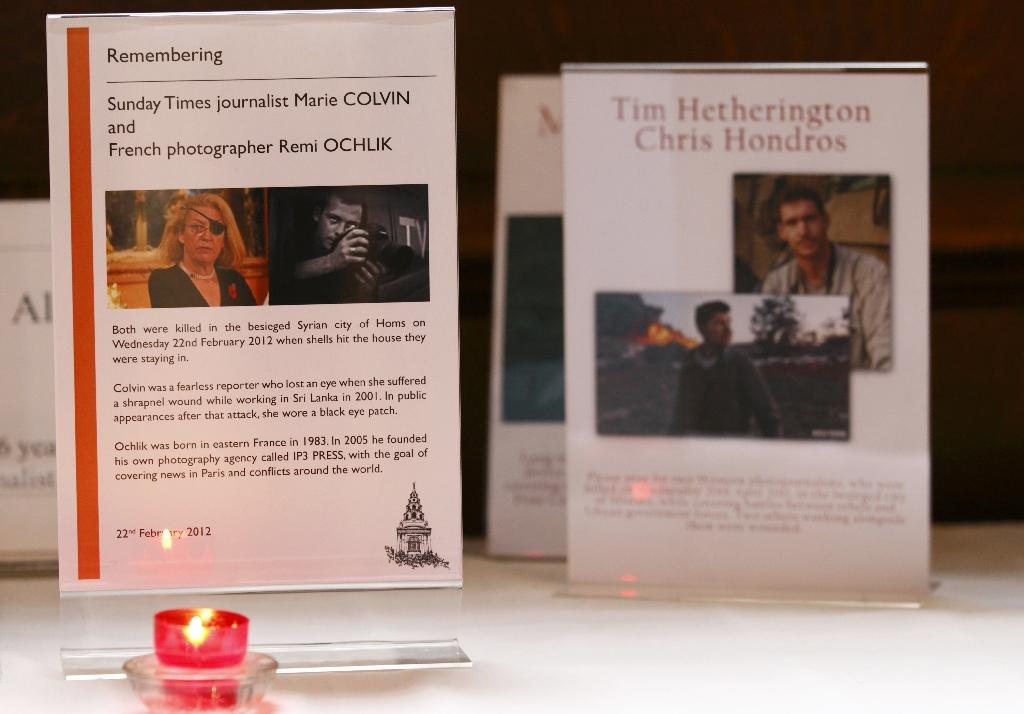 A candle burns in front of a memorial plaque to US-born Sunday Times journalist Marie Colvin and French photographer Remi Ochlik, at St Brides Church on Fleet Street in February 2012 (AFP Photo/Justin Tallis)