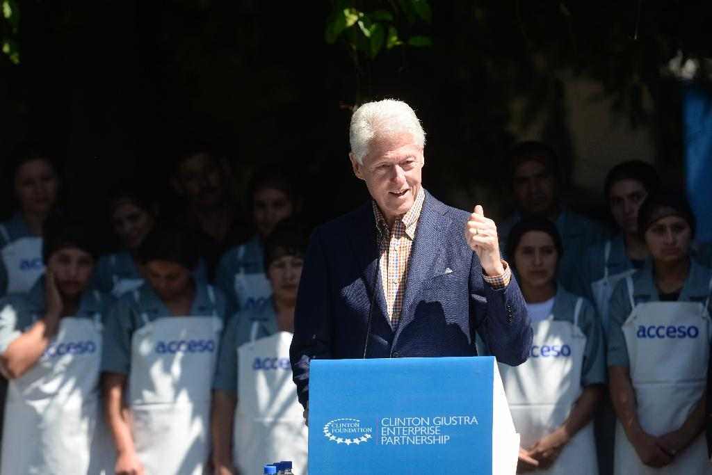 """Bill Clinton, who served as US president from 1993 to 2000, nearly saw his presidency derailed by a sex scandal, but has become a popular figure in the years since, with """"favorable"""" opinion ratings near or above 60 percent in 2015 polls (AFP Photo/Marvin Recinos)"""