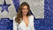 Beach goddess Elizabeth Hurley turns 54 — vote on her iconic swimsuit looks!