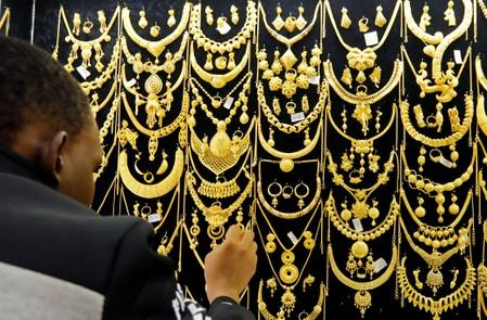 Gold steady as investors eye U.S. retail sales data